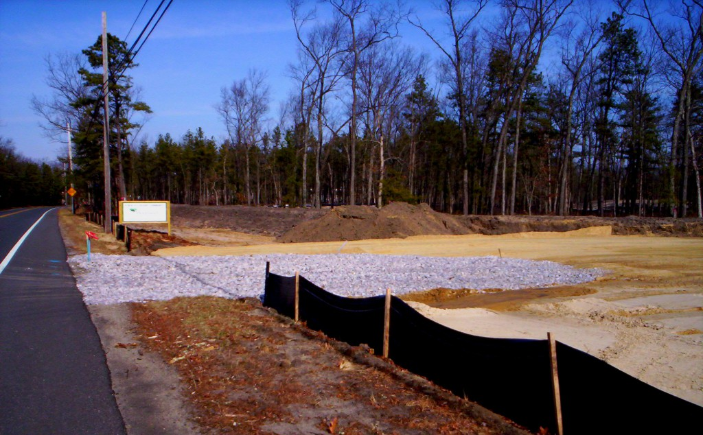 Proper erosion control practices such as the silt fence and stone pad displayed here will help prevent the process of erosion and harmful stormwater runoff from affecting the local environment.