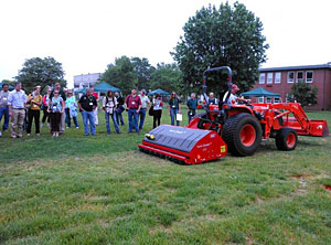 The Vertiquake machine rolls over an area of poor turf quality, and demonstrates how the use of ground penetrating blades